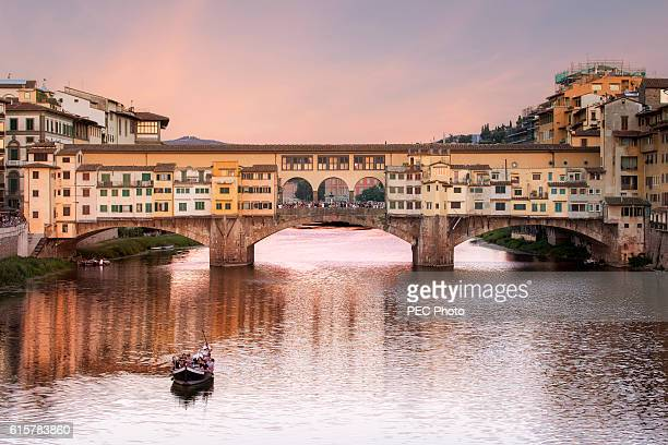 river arno and ponte vecchio in florence - ponte vecchio stock photos and pictures
