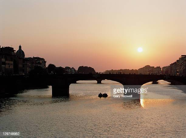 river arno at sunset - yeowell stock pictures, royalty-free photos & images