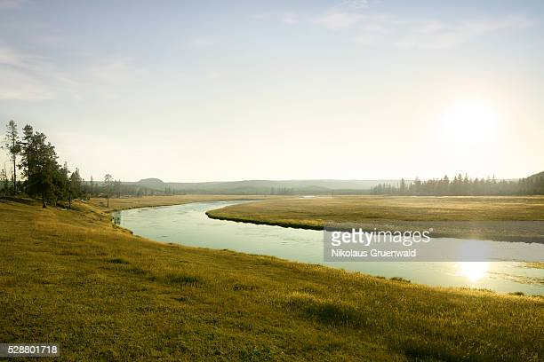 river at sunset in the prairie - wide stock pictures, royalty-free photos & images