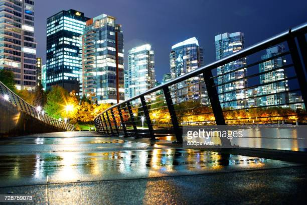 river bridge against illuminated skyscrapers at night, canada - image stock pictures, royalty-free photos & images