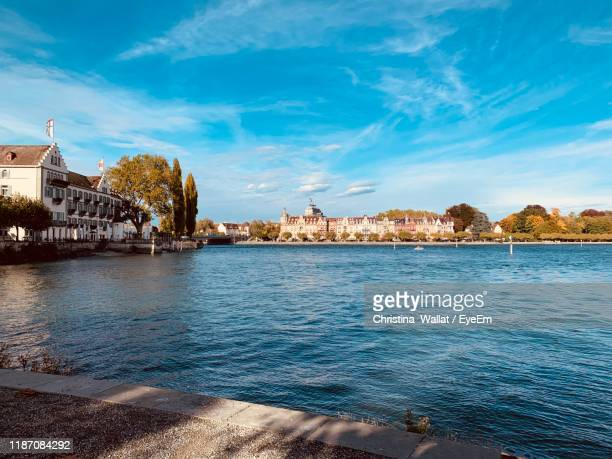 river by buildings against sky in city - bodensee stock pictures, royalty-free photos & images