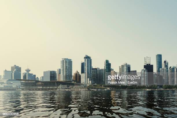 river by city buildings against clear sky - vancouver skyline stock pictures, royalty-free photos & images
