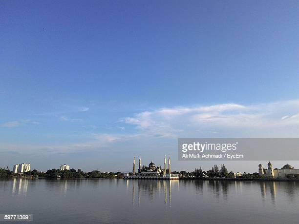 river by crystal mosque in city against sky - crystal mosque stock pictures, royalty-free photos & images
