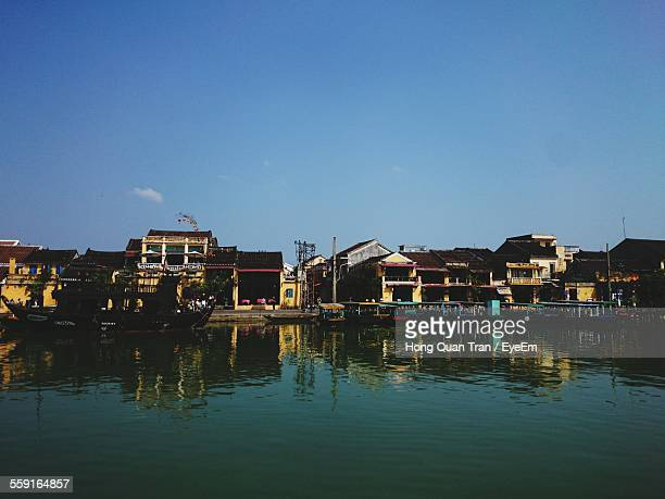 river by houses against clear blue sky - hong quan stock pictures, royalty-free photos & images
