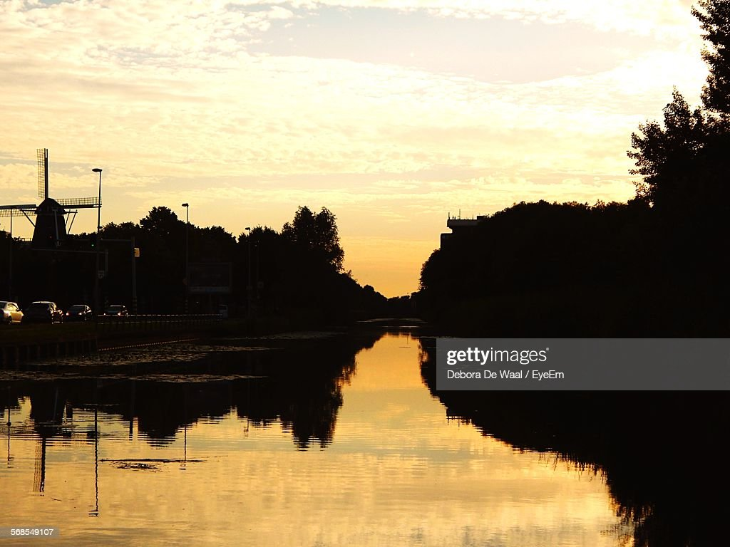 River By Silhouette Trees During Sunset : Stock Photo