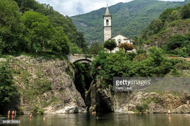 river cannobino at the end of the sant anna ravine, in the background the church of orrido sant anna, cannobio, verbano-cusio-ossola province, piedmont region, italy - province of verbano cusio ossola stock pictures, royalty-free photos & images