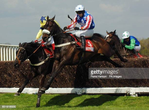 River City and jockey Tom Doyle wins the Betfred Celebration Steeple Chase from Nyrche and jockey Robert Thornton and Contraband and jockey Timmy...