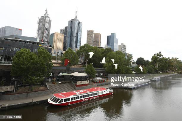 River cruise boats are seen moored along the Yarra River on March 25, 2020 in Melbourne, Australia. Prime Minister Scott Morrison announced further...