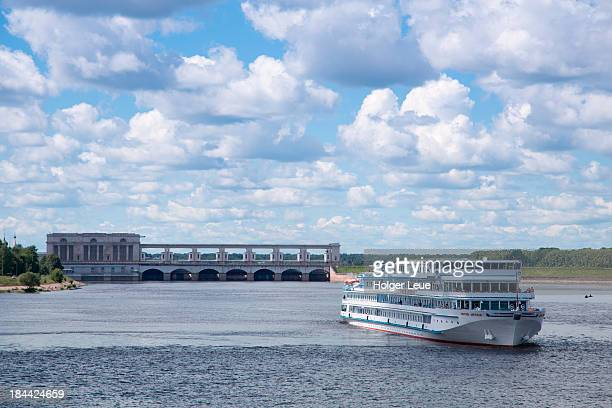 River cruise ship and hydroelectric plant on Volga