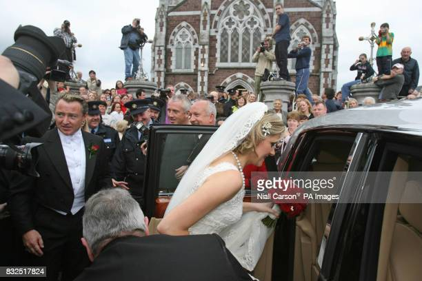 River Dance star Michael Flatley and his wife Niamh O'Brien leave St Patrick's church in Fermoy Co Cork after their wedding today