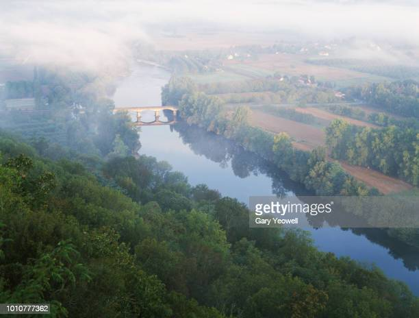 river dordogne and misty landscape at dawn - aquitaine stock photos and pictures