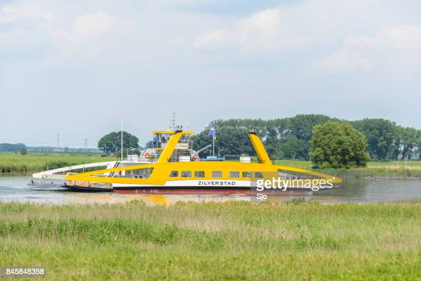 """river ferry on the river ijssel during summer - """"sjoerd van der wal"""" or """"sjo"""" stock pictures, royalty-free photos & images"""