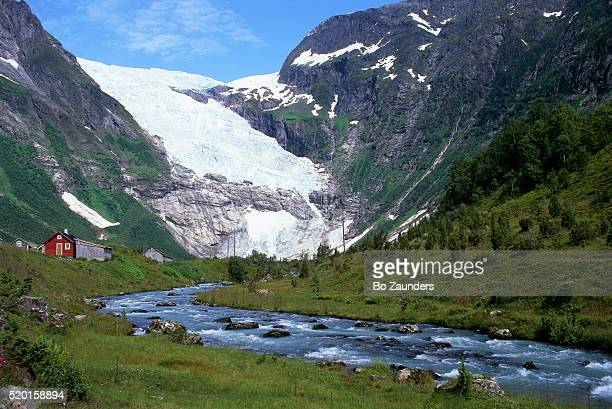 river flowing from briksdal glacier - bo zaunders stock pictures, royalty-free photos & images