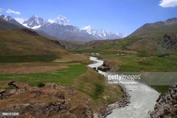 river flowing in mountains and meadows - khyber pass stock pictures, royalty-free photos & images