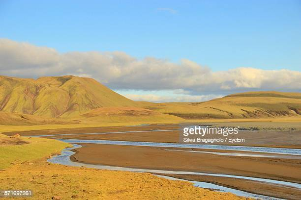 River Flowing Through Barren Landscape