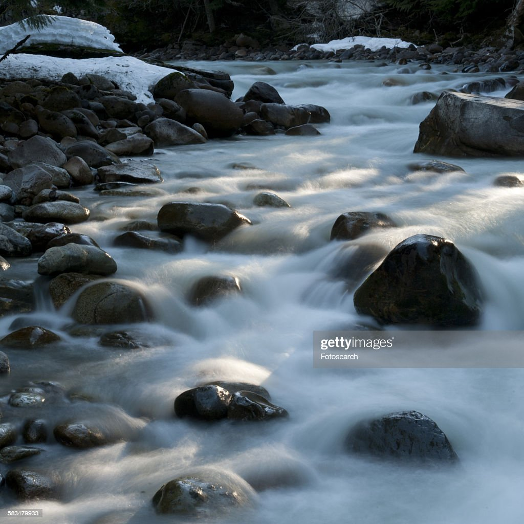 River flowing through rocks : Stock Photo