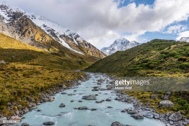 River flowing through valley, Hooker River, at back Mount Cook, Hooker Valley, Mount Cook National Park, Southern Alps, Canterbury Region, Southland, New Zealand