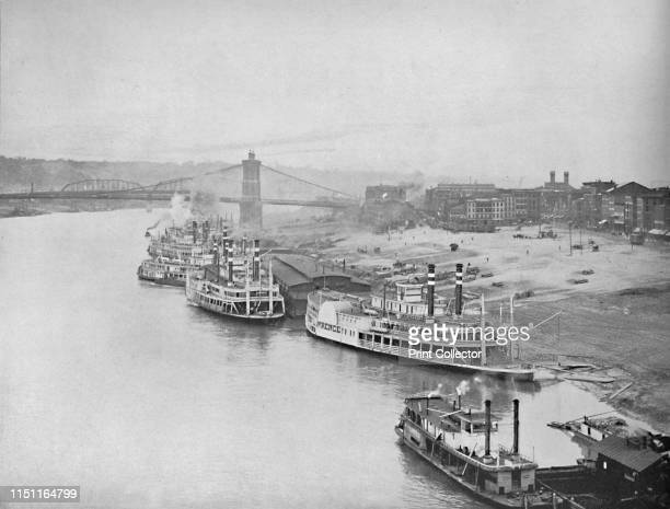 River Front, Cincinnati, Ohio', circa 1897. The John A. Roebling or Cincinnati-Covington Suspension Bridge in Cincinnati, an American boomtown. From...