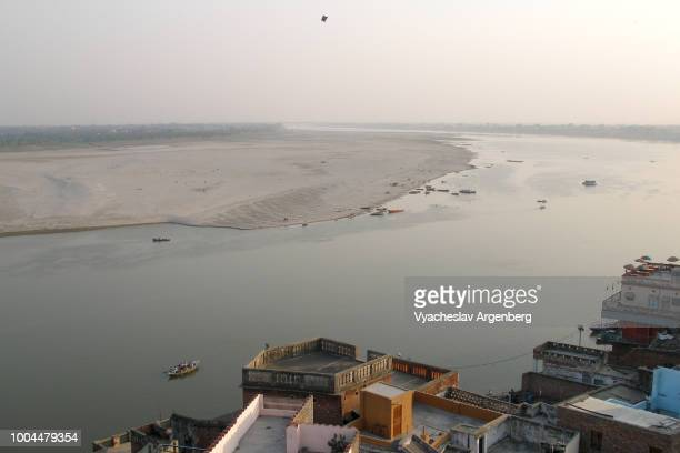 river ganges and vast expanse of sand as seen from varanasi (kashi) urban core, india - argenberg stock pictures, royalty-free photos & images