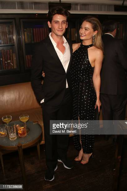 River Hawkins and Emma Rigby attend The Evening Standard Frieze Party at The Arts Club on October 2 2019 in London England