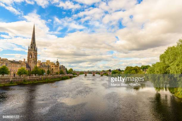 river in city against cloudy sky - perth scotland stock pictures, royalty-free photos & images