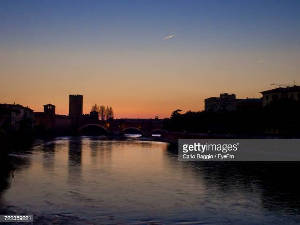 River In City Against Sky At Sunset