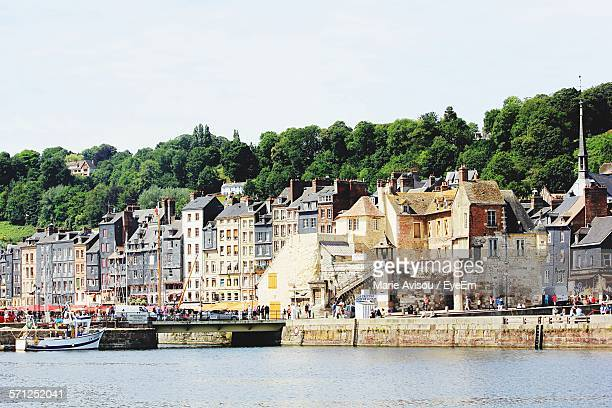 River In Front Of Buildings Against Clear Sky At Honfleur