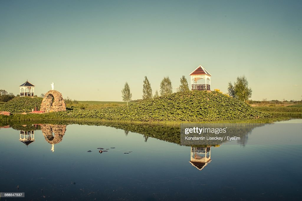 River In Front Of Pavilion On Hill Against Clear Sky : Stock Photo