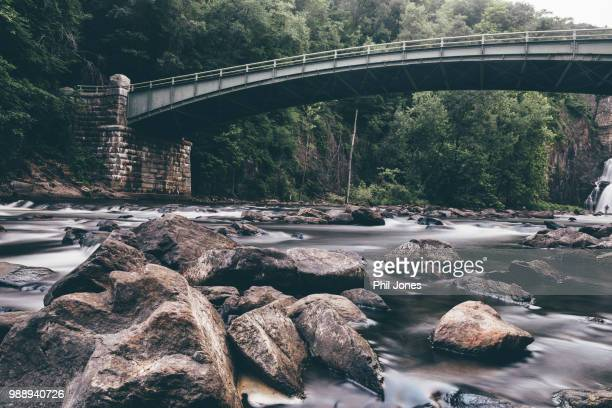 river in long exposure below new croton dam, croton on hudson, new york, usa - westchester county stock photos and pictures