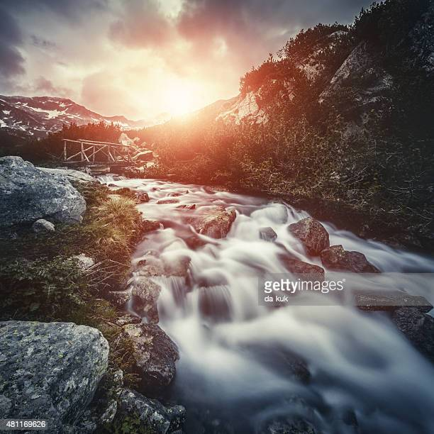 River in mountains at sunset