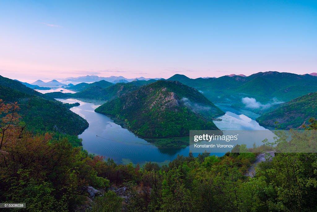 River in the hills. Rijeka Crnojevića and Vranjina hills : Stock Photo