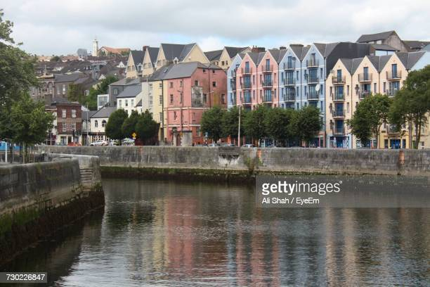 river in town against sky - county cork stock pictures, royalty-free photos & images