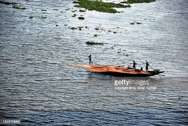 river life - fishing in bangladesh stock photos and pictures