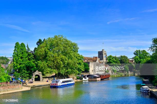 River Medway in the centre of Maidstone Kent England UK All Saints Church and the Archbishops Palace