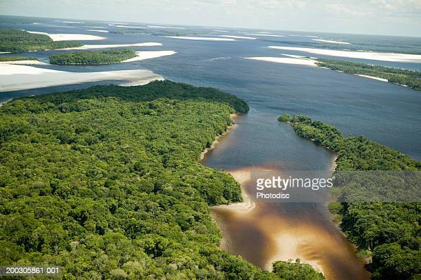 river mouth joining ocean, aerial view - estuary stock pictures, royalty-free photos & images