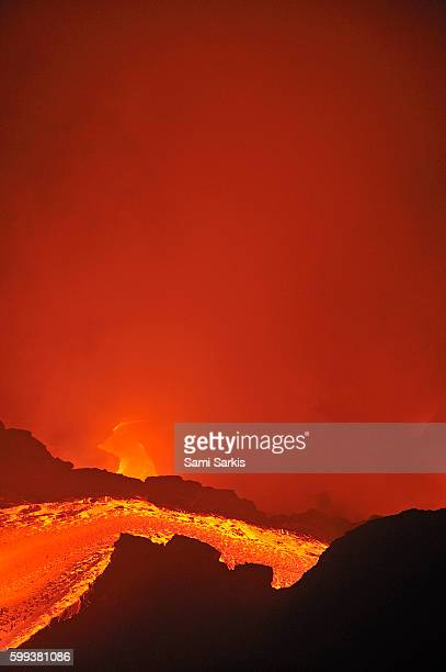 river of molten lava flowing to the sea, kilauea volcano, big island, hawaii islands, usa - media_in_honolulu,_hawaii stock pictures, royalty-free photos & images
