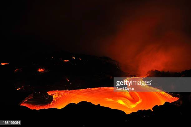 River of molten lava flowing to the sea