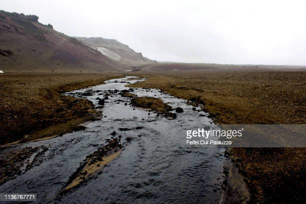 river on the road f902 to askja, central highlands of iceland. - lava plain stock pictures, royalty-free photos & images