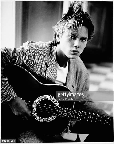 River Phoenix Playing Acoustic Guitar