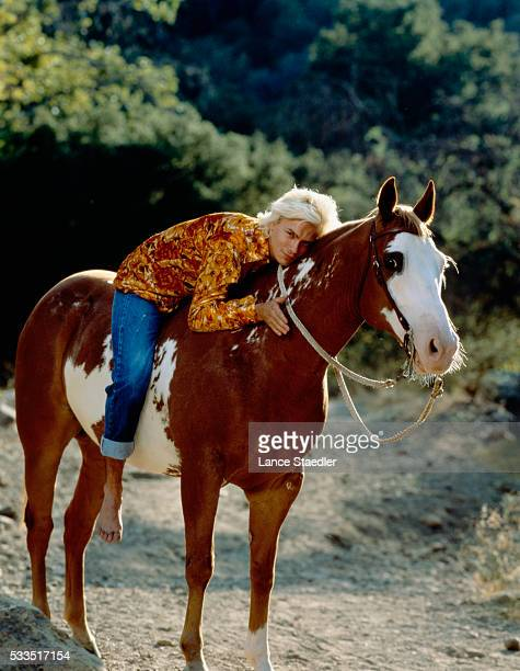 River Phoenix Riding Pinto Horse on Trail