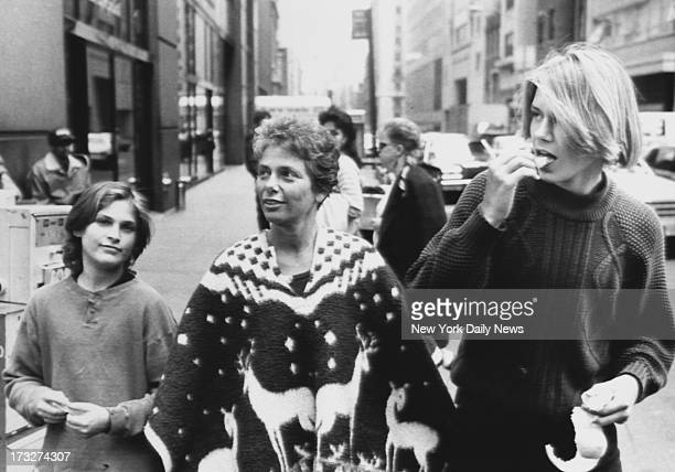 River Phoenix with his younger brother Joaquin Phoenix and mother Arlyn Phoenix walking down 58th Street