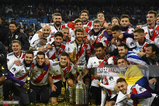 River Plate celebrates with the trophy after winning the second leg match of the allArgentine Copa Libertadores final against Boca Juniors at the...