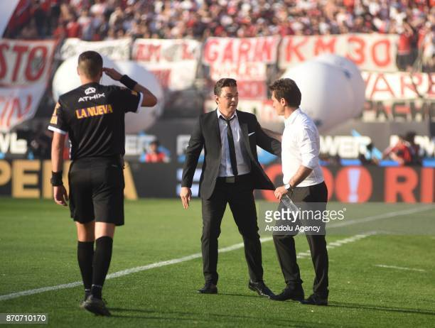River Plate coach Marcelo Gallardo greets Boca Juniors coach Guillermo Barros Schelotto during the match of the eighth soccer match of the Argentine...
