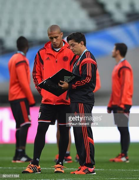 River Plate coach Marcelo Gallardo talks with player Jonatan Maidana during a training session at Osaka Nagai Stadium on December 15 2015 in Osaka...