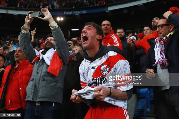 River Plate fans celebrates after Juan Quintero of River Plate scores their team's second goal during the second leg of the final match of Copa...