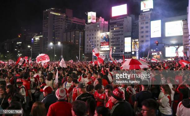 River Plate fans gather at the Obelisco Monument to celebrate their team's victory in the final of the Copa Libertadores in Buenos Aires Argentina on...