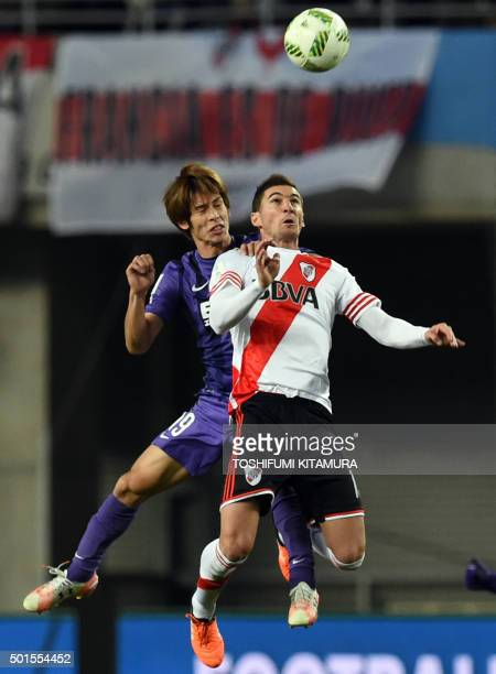 River Plate forward Lucas Alario fights for the ball with Sanfrecce Hiroshima defender Sho Sasaki during their Club World Cup semi-final football...