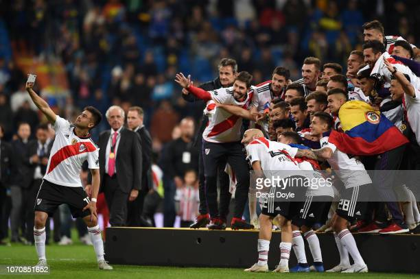 River Plate players take a selfie together as they celebrate following their sides victory in the second leg of the final match of Copa CONMEBOL...