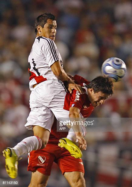 River Plate's Alexis Sanchez vies for the ball with Lucas Pusineri of Independiente during their Argentina first division football match in Buenos...