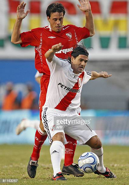 River Plate's Ariel Ortega vies for the ball with Lucas Pusineri of Independiente during their Argentina first division football match in Buenos...